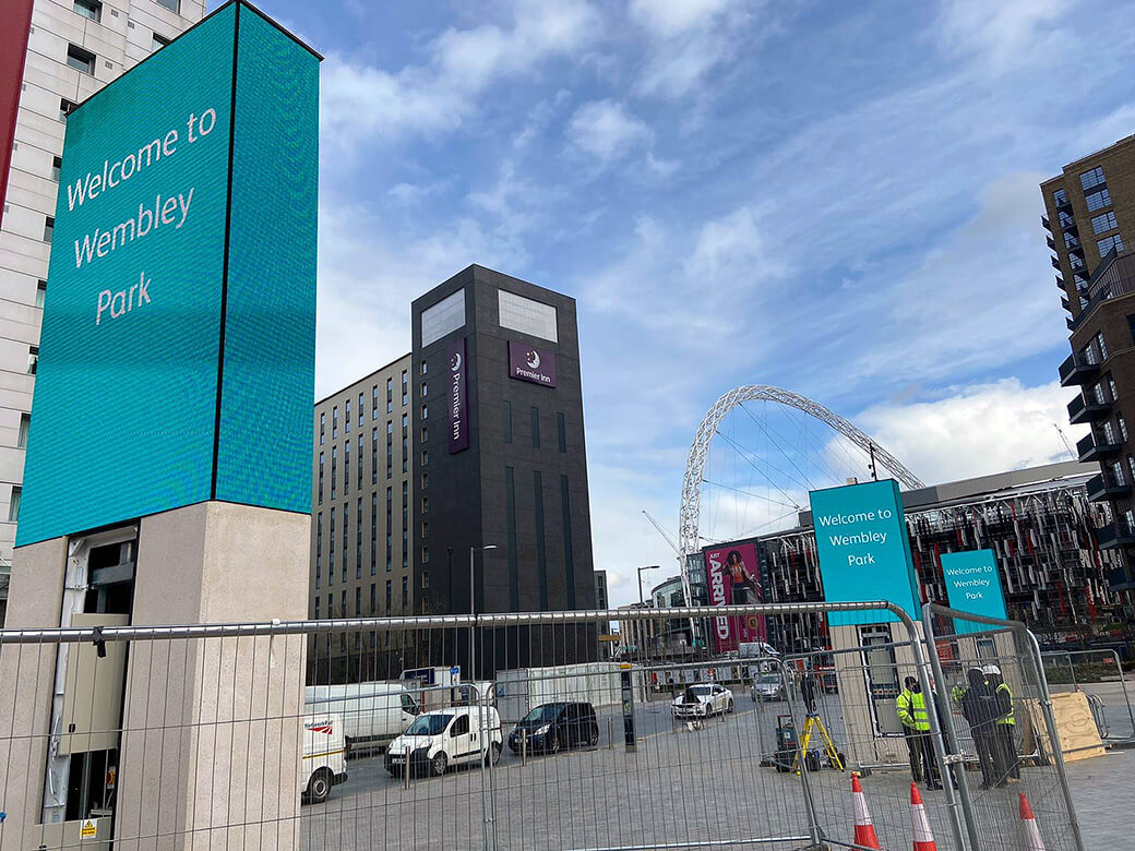 Eclipse Digital Media - Digital Signage and AV Solutions - Wembley Park - White Horse Square LED Totems - Installation with Arch