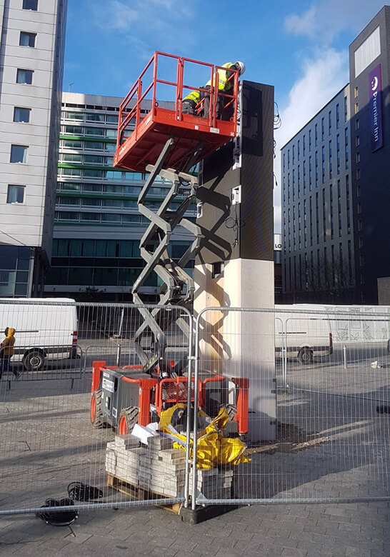 Eclipse Digital Media - Digital Signage and AV Solutions - Wembley Park - White Horse Square LED Totems - Installation Single Skyjack