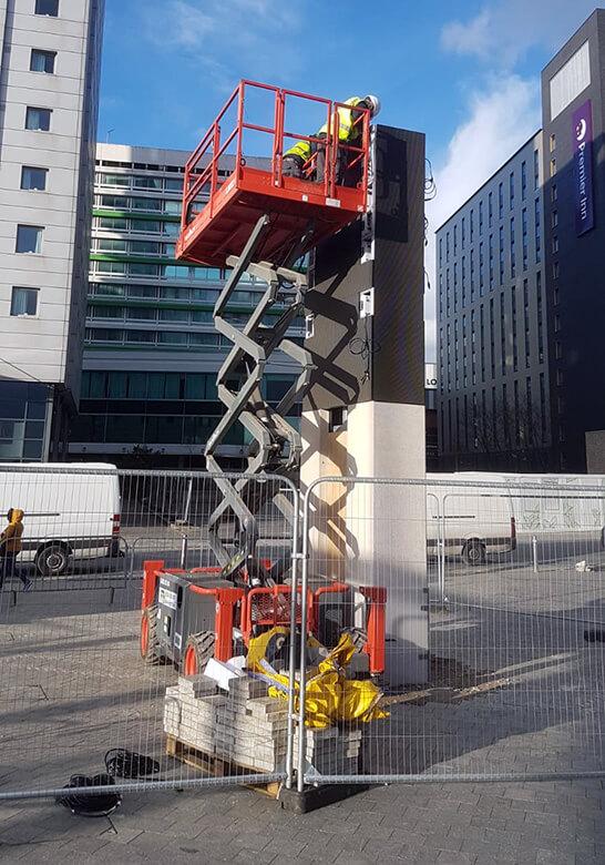 Eclipse Digital Media - Digital Signage and AV Solutions - Wembley Park - White Horse Square LED Totems - Installation Single Skyjack